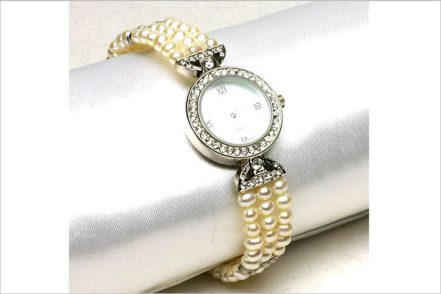 Watches with highest quality pearls FAI WONG INTERNATIONAL TRADING CO.
